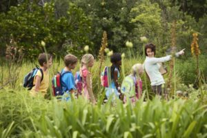 teacher with children on nature field trip