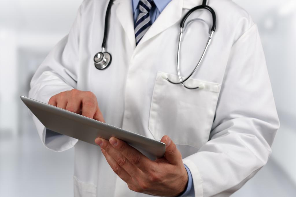 doctor using medical tablet