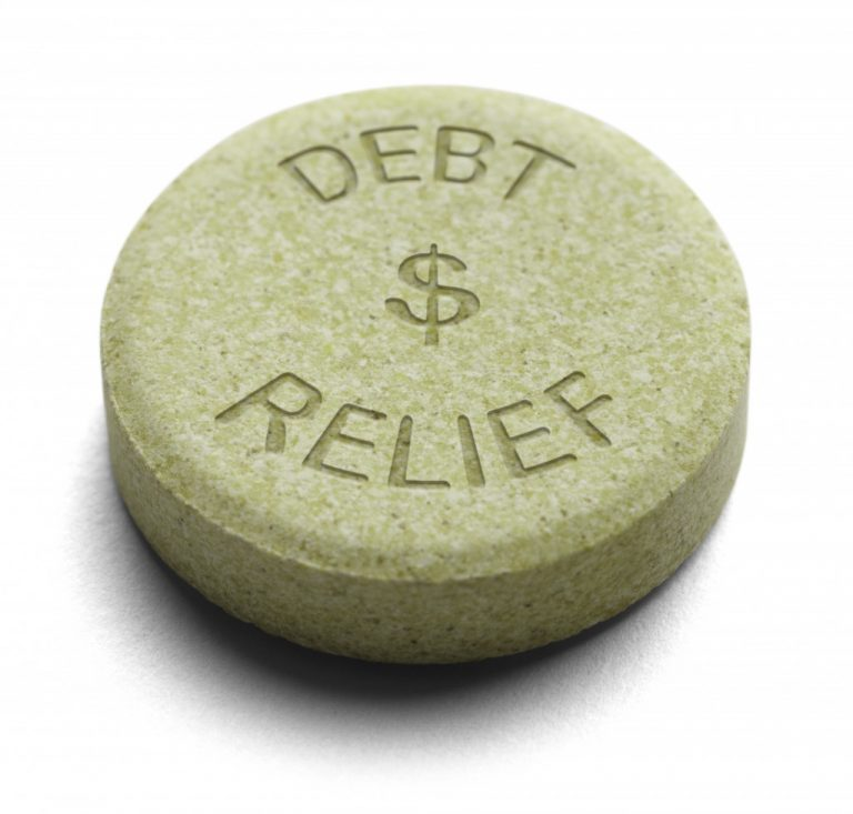 """a stone with the words """"debts relief"""" written on it"""